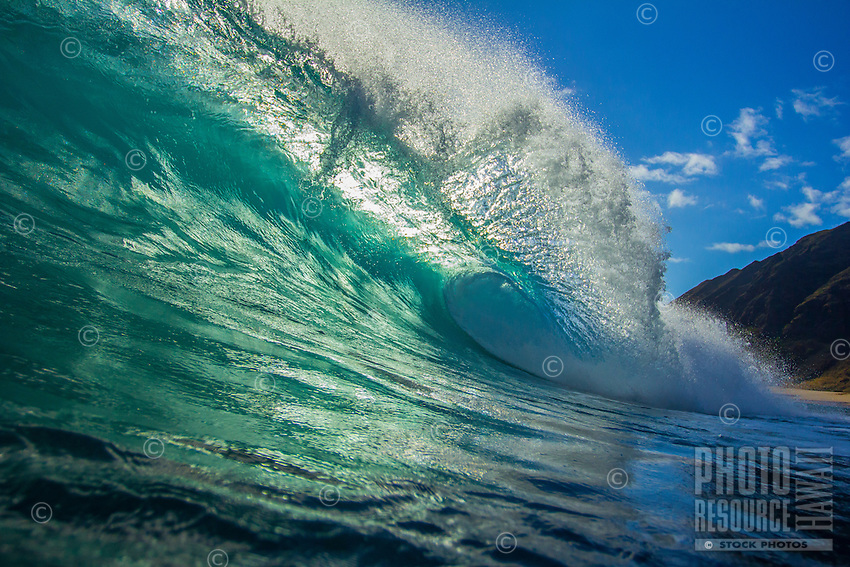 A wave lights up with the backwash, North Shore, O'ahu.