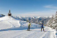 Germany, Bavaria, Upper Bavaria, above Tegernseer Valley, Holy Cross Church at Wallberg mountain, view into Bavarian and Austrian Alps, skiers