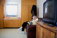 Randy Russo, 60, sits in a tv room after lunch in the residences in Malone Park at the Fernald Developmental Center in Waltham, Massachusetts, USA.  Ronnie and his twin Randy, both blind and unable to speak, have lived at the Fernald Center for 55 years.