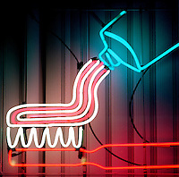 NEON SIGN.Toothbrush.Mixtures of neon and other gases emit bright colors when excited by an electric discharge.