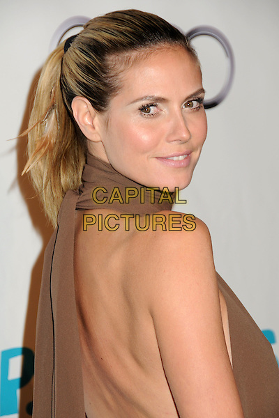 HEIDI KLUM.16th Annual Los Angeles Antiques Show Opening Night Gala Benefiting P.S. Arts held at Barker Hangar, Santa Monica, California , USA..April 13th, 2011.headshot portrait brown high collar sleeveless cut out ponytail looking over shoulder hair up.CAP/ADM/BP.©Byron Purvis/AdMedia/Capital Pictures.