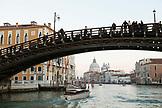 ITALY, Venice.  A view of the Ponte dell' Accademia bridge over the  Grand Canal. The domes of the Basilica di Santa Maria della Salute can be seen in the distance.