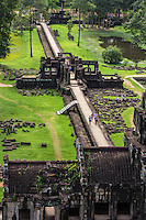 Baphuon is a part of the Angkor Thom complex and was built in the mid-11th century, dedicated to the Hindu God Shiva. In the late 15th century, the Baphuon was converted to a Buddhist temple. The temple was built on sand, but because of its immense size the temple has always been unstable throughout its history. Large portions had collapsed by the time the Buddha was added.  By the twentieth century, most of the temple had collapsed, and restoration efforts have proven to be problematic: a first effort begun in 1960 was interrupted by the Khmer Rouge, when records of the positions of the stones were lost. A second attempt started in 1995 by a team of French archeologists though work is ongoing, the temple has been mostly restored.