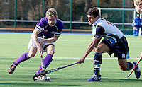 Pete Turner (L) of Sevenoaks is challenged by Jordache Rawson of Hampstead during the England Hockey League Mens Semi-Final Cup game between Hampstead & Westminster and Sevenoaks at the Paddington Recreation Ground, Maida Vale on Sun March 21, 2010