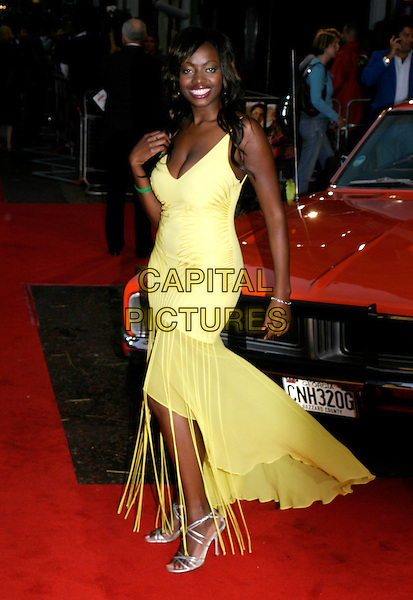"MAKOSI MUSAMBASI.""The Dukes Of Hazzard"" UK Film Premiere, Vue Leicester Square, London..August 22nd, 2005.full length Big Brother yellow dress sheer ruffles tassles.www.capitalpictures.com.sales@capitalpictures.com.© Capital Pictures."