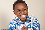 portrait of 8 year old boy closeup horizontal laughing happy