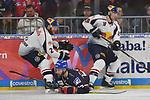 Mannheims Matthias Plachta (Nr.22) gegen Muenchens Andrew Bodnarchuk (Nr.2) und rechts Muenchens Matt Stajan (Nr.18)  beim Spiel in der DEL, Adler Mannheim (blau) - EHC Red Bull Muenchen (weiss).<br /> <br /> Foto &copy; PIX-Sportfotos *** Foto ist honorarpflichtig! *** Auf Anfrage in hoeherer Qualitaet/Aufloesung. Belegexemplar erbeten. Veroeffentlichung ausschliesslich fuer journalistisch-publizistische Zwecke. For editorial use only.