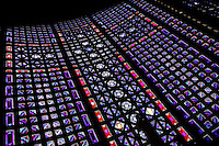 Low angle view of stained glass windows in the church of Notre-Dame du Raincy on May 24, 2009 in Le Raincy, Seine Saint Denis, France. Built in 1922-1923 by the architects and brothers Auguste and Gustave Perret, the cathedral was the first one to be built with reinforced concrete. The stained glass was created by Marguerite Hure based on sketches by Maurice Denis. Picture by Manuel Cohen