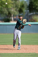 Oakland Athletics shortstop Jhoan Paulino (17) throws to first base during an Instructional League game against the Los Angeles Dodgers at Camelback Ranch on October 4, 2018 in Glendale, Arizona. (Zachary Lucy/Four Seam Images)