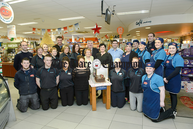 The staff and management celebrate winning a Gold Award (Best Convenience store 400sq +) in the Shelf life National C Store Awards at Talty's Stores at Lissycasey. Included in the photo are Maire Talty, TJ Talty, Grainne Talty,  Oisin talty, Cathal Talty, Oisin Talty and Alan Troy, manager. Photograph by John Kelly.