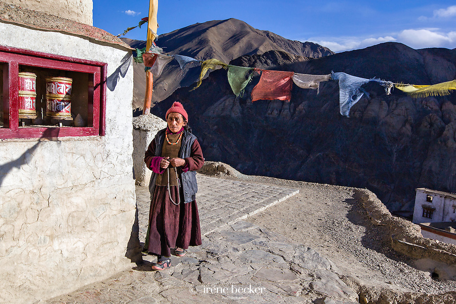 Ladakhi woman repeating buddhist 'mantra'   while doing 'parikrama'  (circular walk around religious place). Lamayuru monastery, Ladakh, Jammu and kashmir, India.