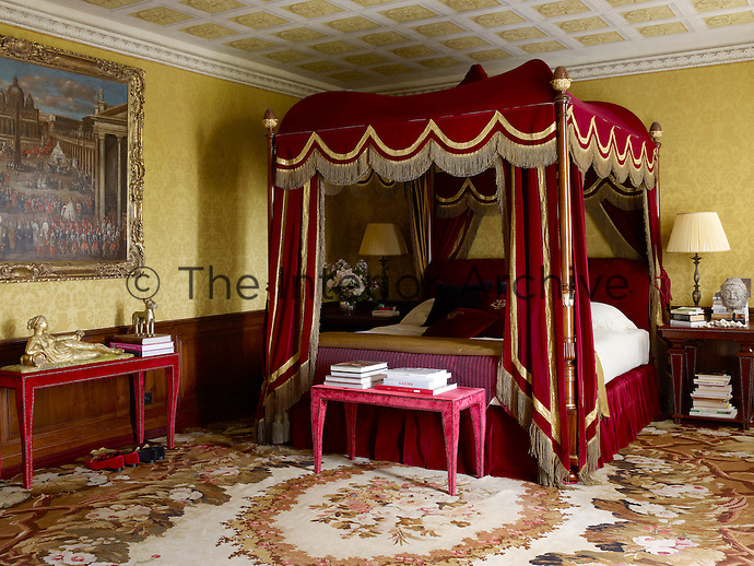 The master bedroom is dominated by a four-poster bed draped in rich velvet hangins embellished with a length of 24-carat gold fringe