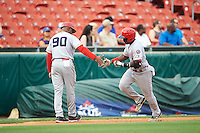 Louisville Bats second baseman Jermaine Curtis (1) congratulated by manager Delino DeShields (90) after hitting a home run during a game against the Buffalo Bisons on June 20, 2016 at Coca-Cola Field in Buffalo, New York.  Louisville defeated Buffalo 4-1.  (Mike Janes/Four Seam Images)
