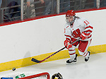 MADISON, WI - SEPTEMBER 29: Erika Lawler #13 of the Wisconsin Badgers women's hockey handles the puck against the Quinnipiac Bobcats at the Kohl Center on September 29, 2006 in Madison, Wisconsin. The Badgers beat the Bobcats 3-0. (Photo by David Stluka)