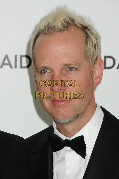 Tom Dumont of No Doubt.20th Annual Elton John Academy Awards Viewing Party held at West Hollywood Park, West Hollywood, California, USA..February 26th, 2012.headshot portrait black white bow tie dyed blonde hair.CAP/ADM/BP.©Byron Purvis/AdMedia/Capital Pictures.
