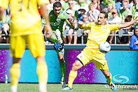 Seattle Sounders FC midfielder Lamar Neagle (27) shoots the ball and scores in a match against Columbus Crew at CenturyLink Field in Seattle, Washington. Seattle Sounders FC defeated Columbus Crew, 6-2.