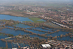 The  Thames, Oxford in  flood . <br /> View North West over the Southern edge of Portmeadow <br /> <br /> The  controversial Roger DudmanWay ( white) buildings  can be seen centre right bordering Portmeadow, hard up against the flooded allotments.