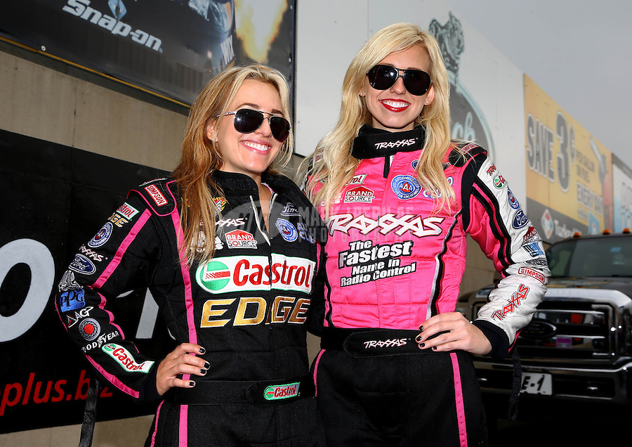 Oct 6, 2013; Mohnton, PA, USA; NHRA funny car driver Courtney Force (right) with sister Brittany Force during the Auto Plus Nationals at Maple Grove Raceway. Mandatory Credit: Mark J. Rebilas-