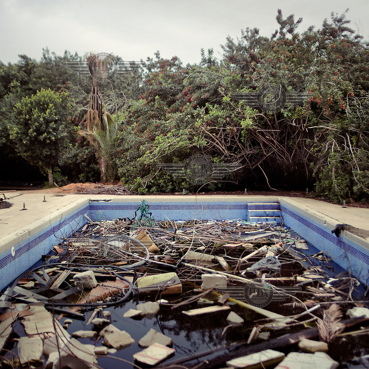 Rubble in a swimming pool in the Gaddafi family's luxurious villa in the Bab al-Aziziya complex.