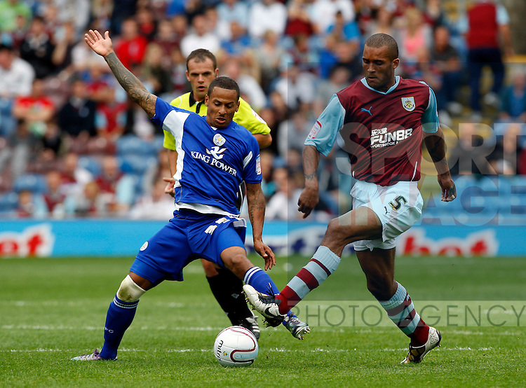 Leicesters DJ Campbell with Burnleys Clarke Carlisle