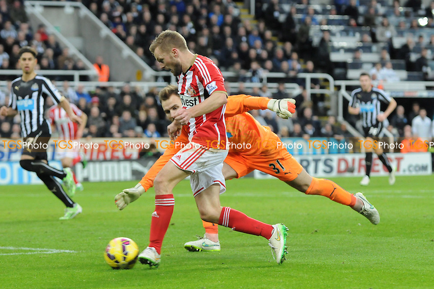 Sebastian Larsson of Sunderland misses after rounding Jak Alnwick of Newcastle United - Newcastle United vs Sunderland AFC - Barclays Premier League Football at St James Park, Newcastle upon Tyne - 21/12/14 - MANDATORY CREDIT: Steven White/TGSPHOTO - Self billing applies where appropriate - contact@tgsphoto.co.uk - NO UNPAID USE