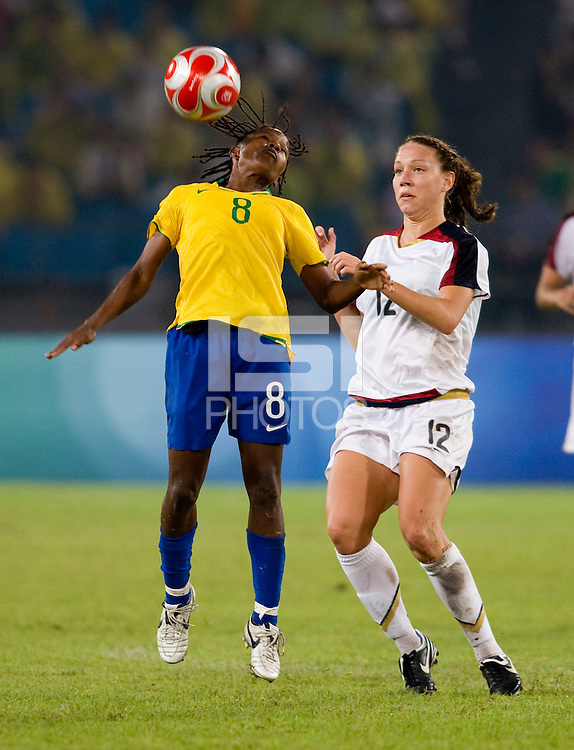 USWNT midfielder (12) Lauren Cheney stays close to  Brazilian defender (8) Formiga while playing for the gold medal at Workers' Stadium.  The USWNT defeated Brazil, 1-0, during the 2008 Beijing Olympic final in Beijing, China.