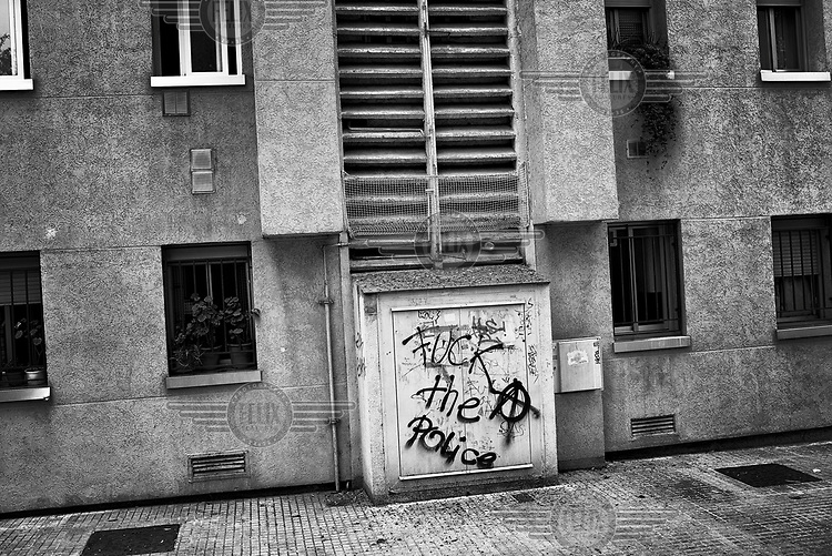 Graffiti reads: 'Fuck the Police' on a building in a neighbourhood where many evictions have taken place.