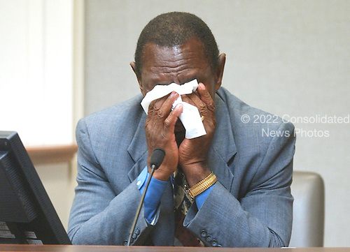 """James Allen Gray Jr., president and publisher of """"Bessemer Daily News"""" in Bessemer, Alabama, wipes his face as he identifies Lee Boyd Malvo during testimony in the trial of sniper suspect John Allen Muhammad at the Virginia Beach Circuit Court in Virginia Beach, Virginia on October 22, 2003.  Gray chased a suspect in a shooting at an Alabama liquor store in 2002. <br /> Credit: Davis Turner - Pool via CNP"""
