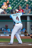 Addison Russell (4) of the Tennessee Smokies at bat against the Mississippi Braves at Smokies Park on July 22, 2014 in Kodak, Tennessee.  The Smokies defeated the Braves 8-7 in 10 innings. (Brian Westerholt/Four Seam Images)