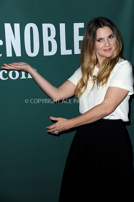 WWW.ACEPIXS.COM<br /> October 27, 2015 New York City<br /> <br /> Drew Barrymore signs copies of 'Wildflower' at Barnes &amp; Noble Union Square on October 27, 2015 in New York City. <br /> <br /> Credit: Kristin Callahan/ACE<br /> <br /> tel: 646 769 0430<br /> Email: info@acepixs.com<br /> www.acepixs.com