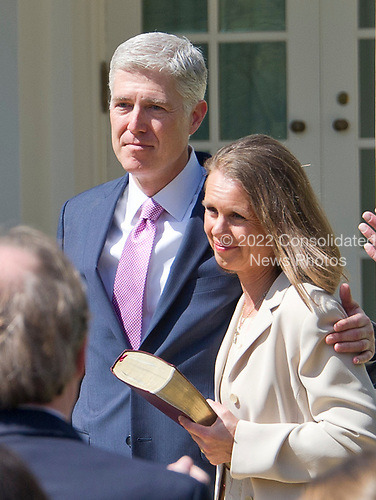 Associate Justice of the United States Supreme Court Neil Gorsuch and his wife, Louise, following the Oath of Office ceremony in the Rose Garden of the White House in Washington, DC on Monday, April 10, 2017.<br /> Credit: Ron Sachs / CNP<br /> (RESTRICTION: NO New York or New Jersey Newspapers or newspapers within a 75 mile radius of New York City)