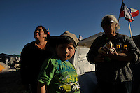 relatives and frieds of the 33 miners trapeds 700 meters under the ground since August 5th pray and wait outside the collapsed tunnel in San Jose mine, Copiapo, North of Chile