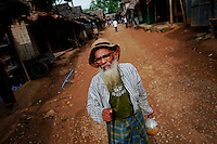"Wa Ha, a 82 year old Muslim Burmese refugee carries food at the Mae La refugee camp near Mae Sot June 3, 2012. Asked about Aung San Suu Kyi's visit to the camp Wa Ha said ""I like her and I have hope in her but not sure if she can change anything for me. I'm too old and I just want to die here. Life and death are better here in the camp than in Myanmar."" Myanmar's pro-democracy leader Aung San Suu Kyi visited on Saturday Mae La, the biggest refugee camp along the Thailand-Myanmar border where tens of thousands of her compatriots found shelter after escaping from Myanmar.  REUTERS/Damir Sagolj (THAILAND)"