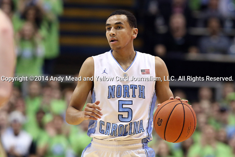 03 December 2014: North Carolina's Marcus Paige. The University of North Carolina Tar Heels played the University of Iowa Hawkeyes in an NCAA Division I Men's basketball game at the Dean E. Smith Center in Chapel Hill, North Carolina. Iowa won the game 60-55.
