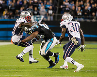 The Carolina Panthers play the New England Patriots at Bank of America Stadium in Charlotte North Carolina on Monday Night Football.  The Panthers defeated the Patriots 24-20.  New England Patriots cornerback Kyle Arrington (25), New England Patriots defensive back Duron Harmon (30), Carolina Panthers running back Jonathan Stewart (28)