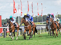 03.08.2013 Goodwood, England.  over the finish line during day five of the  Glorious Goodwood Festival. winner of the Feature race 3.15 The Markel Insurance Nassau Stakes (British Championship Series). Group 1- Winsili ridden by William Buick trained by John Gosden