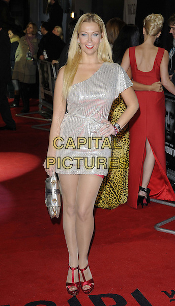 Liz Fuller.'The Girl With The Dragon Tattoo' World film Premiere, Odeon Leicester Square, London, England..12th December 2011.full length white silver one shoulder sequins sequined red sandals shoes bag purse hand on hip.CAP/CAN.©Can Nguyen/Capital Pictures.