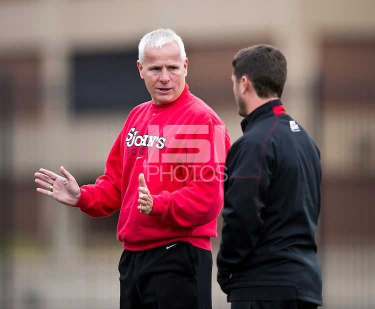 St. John's head coach Dave Masur talks to assistant coach Jeff Matteo during halftime at North Kehoe Field in Washington DC. Georgetown defeated St. John's, 2-1, in the Big East conference tournament quarterfinals.