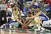 Players dive for the ball in the second half. This game was one of the two Semifinal games of the 2011 ACC Tournament in Greensboro on Saturday, March 5, 2011. Duke beat Georgia Tech 74-66. (Photo by Al Drago)