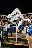 Batavia Muckdogs fan runs through the stadium with the team flag during a game against the Mahoning Valley Scrappers on July 3, 2015 at Dwyer Stadium in Batavia, New York.  Batavia defeated Mahoning Valley 7-4.  (Mike Janes/Four Seam Images)