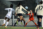 21 November 2014: North Carolina's Maya Worth (5) scores the game-winning sudden death goal in overtime past Colorado's Kate Scheele (1) and Alex Huynh (AUS) (3). The University of North Carolina Tar Heels hosted the University of Colorado Buffaloes at Fetzer Field in Chapel Hill, NC in a 2014 NCAA Division I Women's Soccer Tournament Second Round match. UNC won the game 1-0 in overtime.