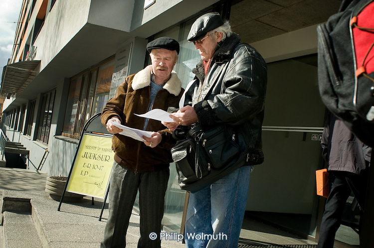 Two unemployed men look at print-outs of job vacancies outside the Tallinn Labour Market Board (unemployment office).   Estonia has been badly hit by the economic crisis.