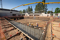 Concrete is poured for the first time in the new De Mandel Aquatic Center.<br /> Occidental's new 58,000 square-foot complex will make it possible for Oxy's swimming, diving, water polo and tennis teams to train and compete in facilities that meet NCAA and conference standards.<br /> Photographed April 26, 2019.<br /> (Photo by Marc Campos, Occidental College Photographer)