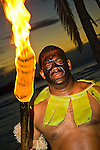 Local Fijian torch lighter, part of ceremony performed at resorts at sunset.
