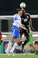 Montreal Impact forward Bernardo Corradi (23) heads the ball against D.C. United defender Brandon McDonald (4) D.C. United tied The Montreal Impact 1-1, at RFK Stadium, Wednesday April 18 , 2012.
