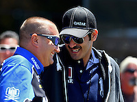 Jul. 28, 2013; Sonoma, CA, USA: NHRA top fuel dragster driver Brandon Bernstein (left) talks with Sheikh Khalid Bin Hamad Al Thani during the Sonoma Nationals at Sonoma Raceway. Mandatory Credit: Mark J. Rebilas-