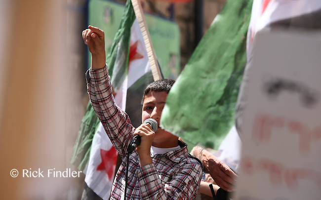 Photographer: Rick Findler..27.04.12 A young boy leads the anti Assad chants at a rally against President Assad's regime in Armanaz, Northern Syria. The people in Syria still protest against Assad's evil ways, and a ceasefire is far from over after yet another battle in Idlib City today.