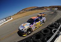 Jun. 21, 2009; Sonoma, CA, USA; NASCAR Sprint Cup Series driver David Reutimann (00) leads teammate Patrick Carpentier (55) during the SaveMart 350 at Infineon Raceway. Mandatory Credit: Mark J. Rebilas-
