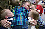 Lt. Nigel Harrison gets a group hug from his children, Jack, Halen, Scarlet and Beckham as he and fellow Nevada Army Guard soldiers arrive at the Reno-Tahoe International Airport in Reno, Nev., on Sunday, Feb. 16, 2014. About 300 supporters greeted the 1/168th General Support Battalion after a 10-month deployment in Afghanistan. (Las Vegas Review-Journal/Cathleen Allison)