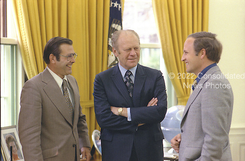 United States President Gerald R. Ford chats with Chief of Staff Donald Rumsfeld and Rumsfeld's assistant Richard Cheney in the Oval Office of the White House in Washington, DC on April 28, 1975.<br /> Mandatory Credit: David Hume Kennerly / White House via CNP